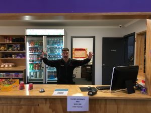 Leap staff member at reception waving their arms in the air in excitement